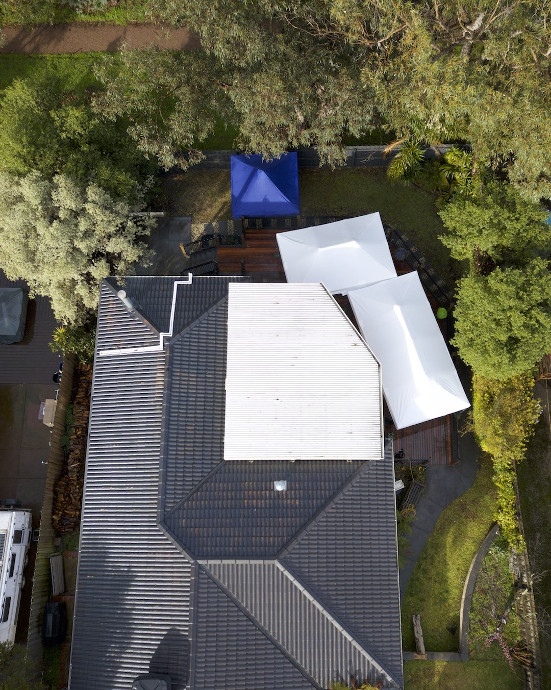 Altegra event marquees can be set up to cover backyard events in all shapes - white 3x6m marquee and 3x4.5m gazebo on a deck.