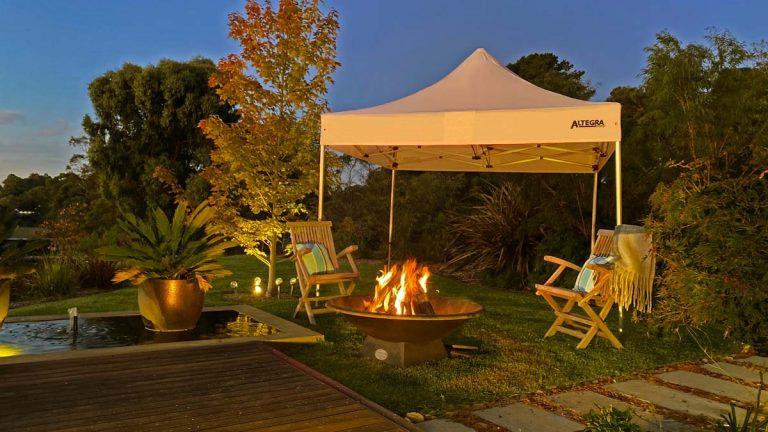 3x3m gazebo for backyard camping by Altegra - white gazebo set up for shelter while enjoying your backyard.