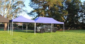 Altegra Heavy Duty 4x4 Marquee and 4x8m Marquee image sheltering a parked truck showing its huge marquee coverage span.