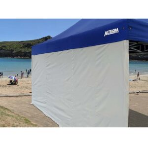 Altegra 3x4.5m gazebo walls - UPF50+ sun protection, 100% waterproof walls and wall kits that attach across the full length of the gazebo canopy to enhance your 3x4.5m gazebo inner space - gazebo door wall shown in white attached to the royal blue Altegra 3x4.5m canopy.