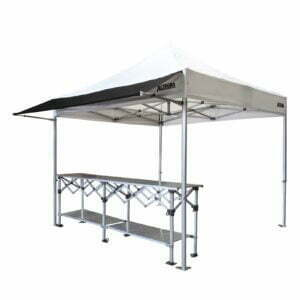 Altegra 3m Gazebo Awning in black attached to a 3x3m Heavy Duty gazebo with white canopy and paired with a 3m aluminium folding table - a perfect market stall, exhibitor stand, or entertaining tent starter kit.